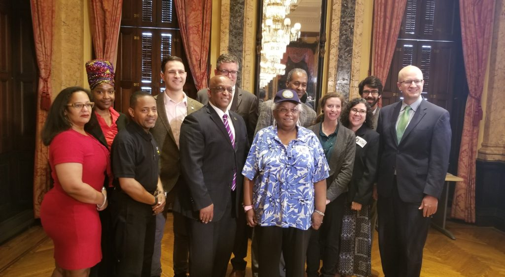 Advocates with Mayor Jack Young at bill signing.