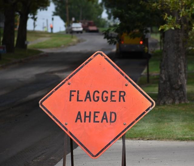 Flagger traffic sign